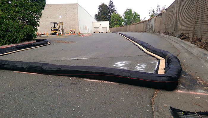Rohnert Park, CA SWIMS install of DuraWattle on asphalt.